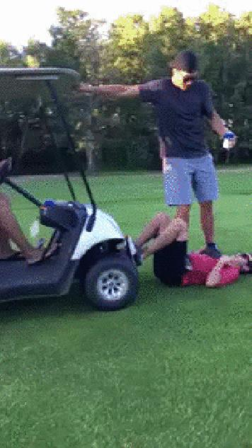 A golfer surfs the belly of his buddy
