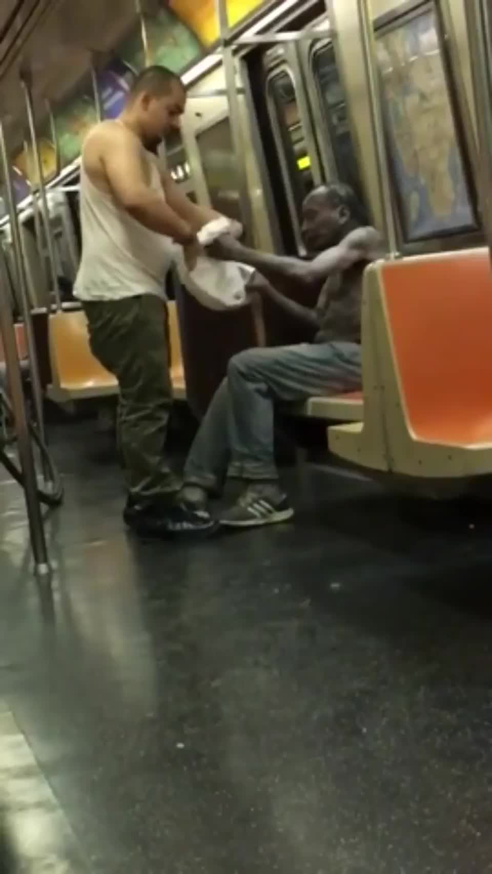 ⁣A man gave his t-shirt to a homeless man on an NYC Subway