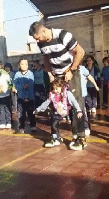 A sports teacher helps a handicapped girl to dance 👏👏