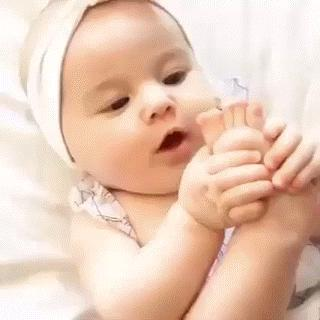 Cute babye eating his foot