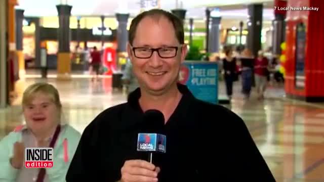 ⁣Girl Steals Spotlight From Live TV Reporter