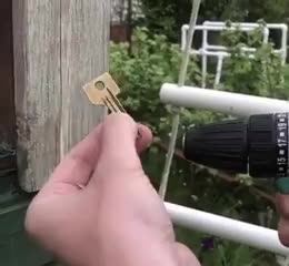 ⁣Power drill and a key to easily screw in a hook